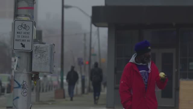 man wearing a mask crosses maryland avenue through a thick layer of fog during the coronavirus pandemic on december 12, 2020 in baltimore, maryland.... - housing difficulties stock videos & royalty-free footage