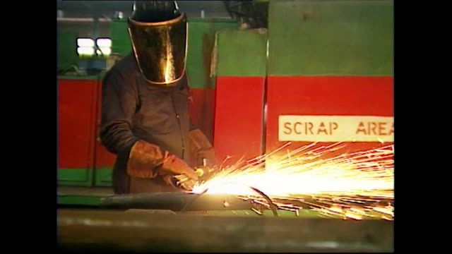 man wearing a mask welds pipes in industrial building; 1997 - obscured face stock videos & royalty-free footage