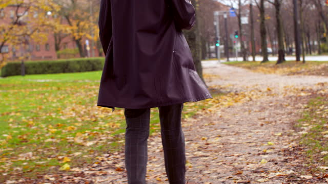 man wearing a raincoat walking - city street stock videos & royalty-free footage