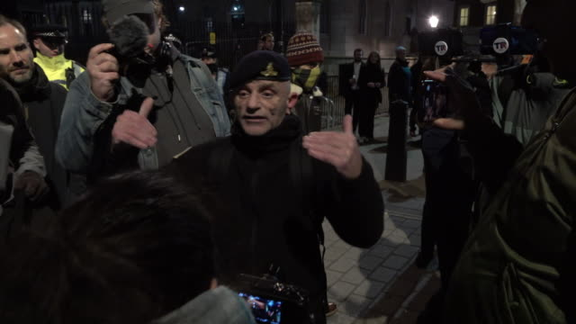 a man wearing a soldier's uniform shouts offensive and racist language towards antiracist protestors opposite downing street during protests against... - anti racism stock videos & royalty-free footage