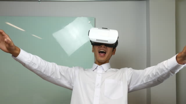 man wearing and working with virtual reality glasses - relief emotion stock videos and b-roll footage
