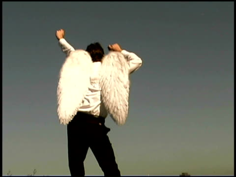 man wearing angel wings dancing - one mid adult man only stock videos & royalty-free footage