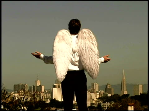 man wearing angel wings - one mid adult man only stock videos & royalty-free footage