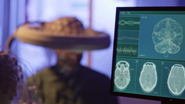 man wearing brainwave scanning headset. - medical equipment stock videos & royalty-free footage