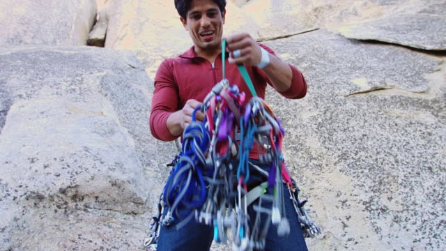 man wearing climbing harness sorting through slcds - angeles national forest stock videos and b-roll footage