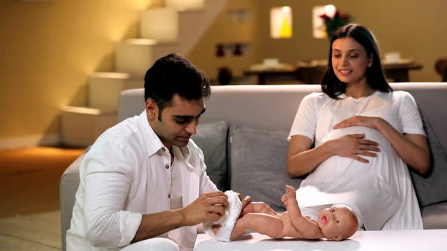 man wearing diaper to baby dummy, delhi, india - nappy stock videos and b-roll footage