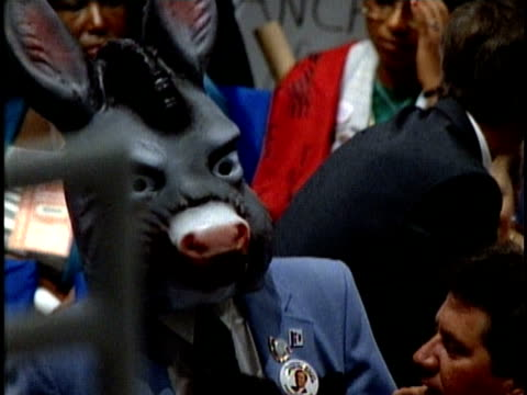 vídeos de stock, filmes e b-roll de man wearing donkey mask at democratic national convention in july 1988 / atlanta, georgia, usa - documentário
