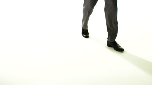 slo mo, cu, man wearing dress shoes and trousers walking in studio, low section - dress shoe stock videos and b-roll footage