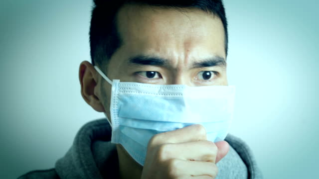 man wearing face mask because of coughing - asian man coughing stock videos & royalty-free footage
