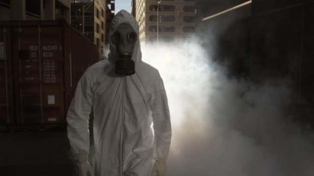 SLO MO MS REAR POV Man wearing HAZMAT suit and gas mask, Atlanta, Georgia, USA