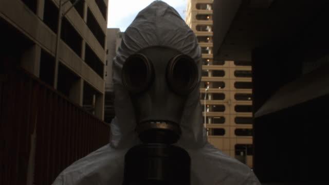 CU Man wearing HAZMAT suit and gas mask, Atlanta, Georgia, USA