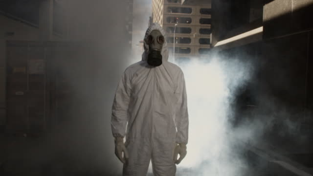 SLO MO MS Man wearing HAZMAT suit and gas mask in smoke, Atlanta, Georgia, USA