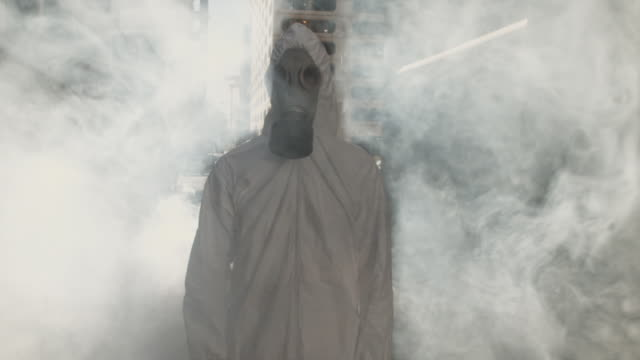 slo mo ms man wearing hazmat suit and gas mask in smoke, atlanta, georgia, usa - gas mask stock videos & royalty-free footage