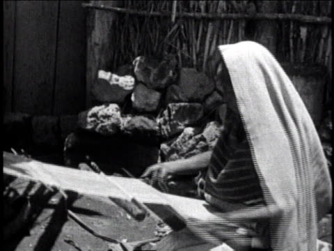 1930 ms man wearing head covering working at a loom / mexico city, mexico - reporterstil stock-videos und b-roll-filmmaterial