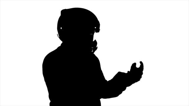 Man Wearing Helmet Puts On Gloves