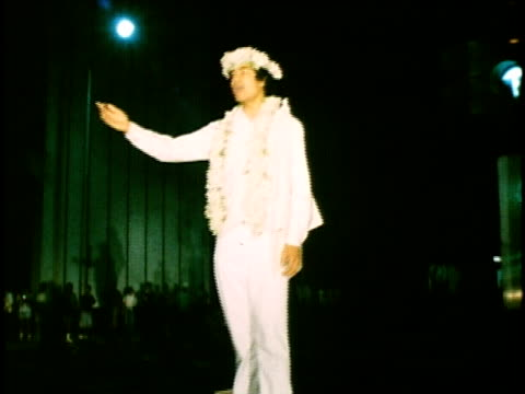 Man wearing lei and singing song in Hawaiian before the start of Honolulu Marathon race/ Oahu Hawaii Islands USA/ AUDIO