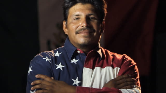 MS SLO MO Man wearing Mexican and American flag shirts / Homestead, Florida, USA