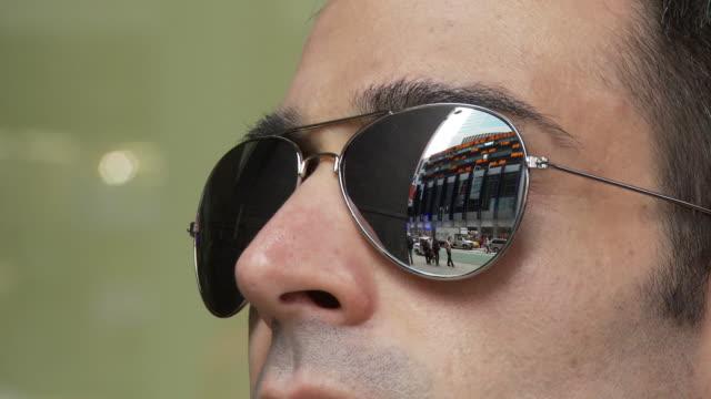 ZI ECU Man wearing mirror shades reflecting street / New York City, New York, USA