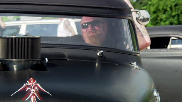 ms, man wearing sunglasses sitting in vintage car, jacksonville, florida, usa - see other clips from this shoot 1403 stock videos and b-roll footage