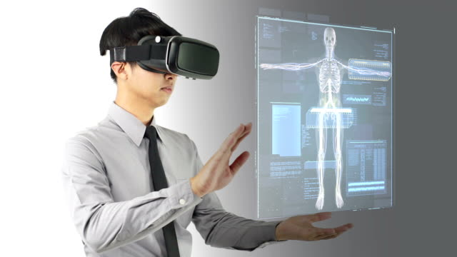 a man wearing virtual reality headset for diagnose. - holographic stock videos and b-roll footage