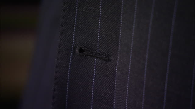 a man wears a gray pinstripe suit. - pinstripe stock videos & royalty-free footage