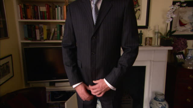 a man wears a pinstripe suit and tie. - pinstripe stock videos & royalty-free footage