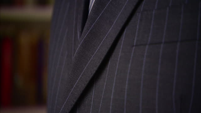 a man wears a pinstripe suit and tie. - suit stock videos & royalty-free footage