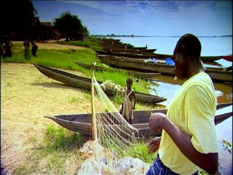 Man weaves fishing net Democratic Republic of Congo