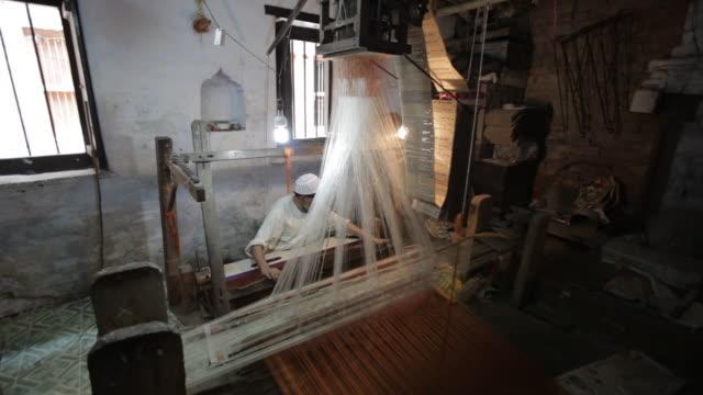 WS Man weaving sari on loom / Varanasi, India