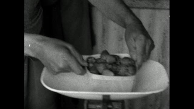 man weighs and wraps punnets of strawberries; 1956 - trug stock videos & royalty-free footage