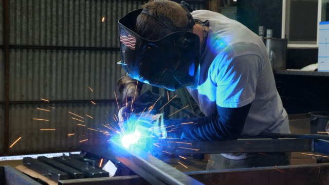 ms man welding frame in metal shop - blonde hair stock videos & royalty-free footage