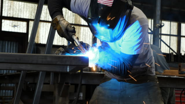 ms la man welding frame in metal shop - manufacturing occupation stock-videos und b-roll-filmmaterial