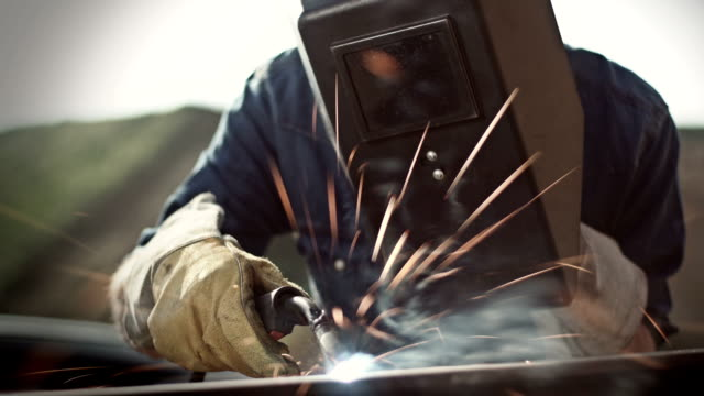 man welding outside - girder stock videos & royalty-free footage