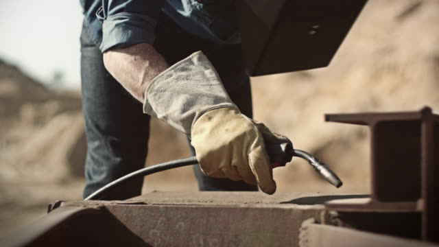 man welding outside - glove stock videos & royalty-free footage