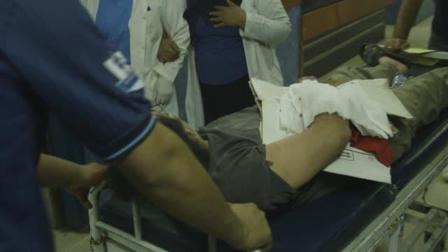 man wheeled through baghdad hospital on stretcher - baghdad stock videos & royalty-free footage