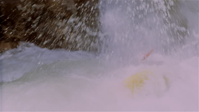 Man whitewater kayaking down waterfall and flipping over in kayak / kayaker regaining balance in kayak / Lake Creek, Colorado Rockies