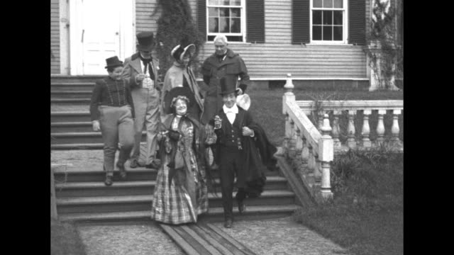 man who is possibly harvard university pres a lawrence lowell greets an enthusiastic group of people in 1827style costumes the cast of the pickwick... - charles dickens stock videos & royalty-free footage