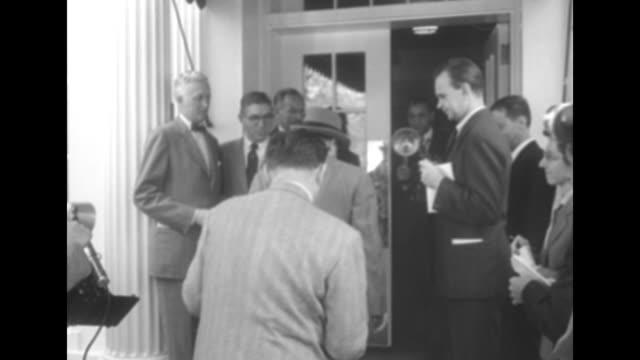 Man who might be Attorney General J Howard McGrath decars walks through press scrum to White House entrance walks inside / McGrath exits speaks...
