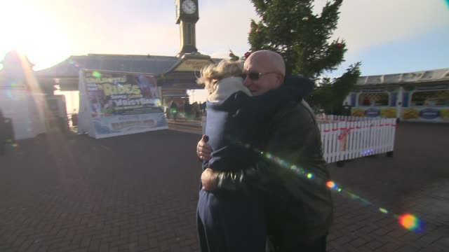 man who suffered heart attack on brighton pier reunited with woman who saved his life; england: east sussex: brighton: ext brian smith being reunited... - mel smith stock-videos und b-roll-filmmaterial