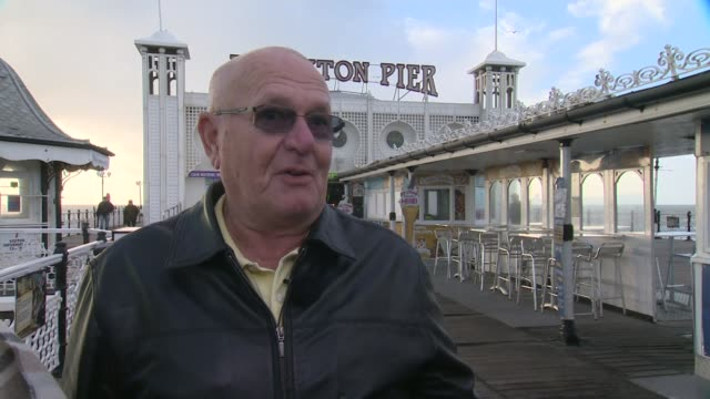 man who suffered heart attack on brighton pier reunited with woman who saved his life; people on pier brian smith interview sot mel armstrong... - mel smith stock-videos und b-roll-filmmaterial