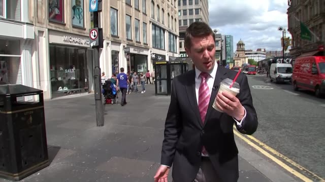 vidéos et rushes de man who threw milkshake at nigel farage ordered to pay him compensation england newcastle reporter to camera - milk shake