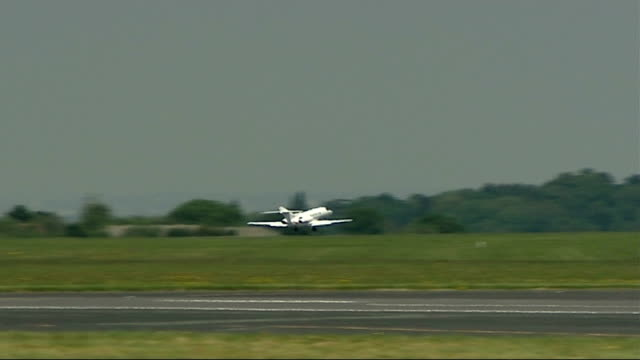 man who won a private jet cannot afford fuel to fly it; kent: biggin hill airfield: plane taking off from runway and in flight - biggin hill stock videos & royalty-free footage