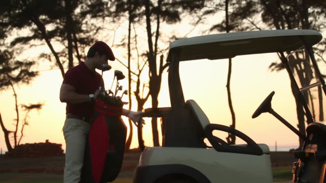 Man winding up his game after playing golf