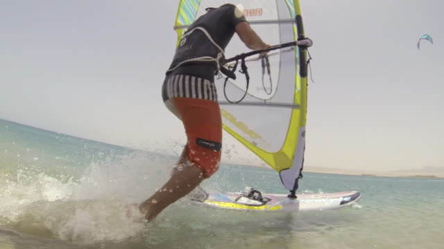 a man windsurfing on the red sea in egypt. - slow motion - cool attitude stock videos & royalty-free footage
