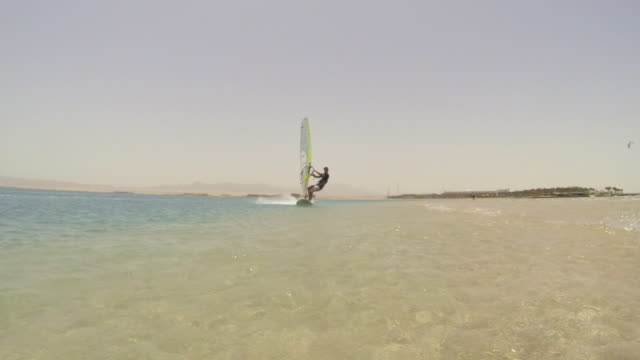 A man windsurfing on the Red Sea in Egypt.
