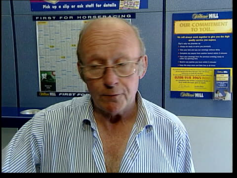man wins half a million pounds from a 30p bet vox pops punters gv betting shop as customers along punters at counter in bookmakers cs hands filling... - black entertainment television stock videos & royalty-free footage