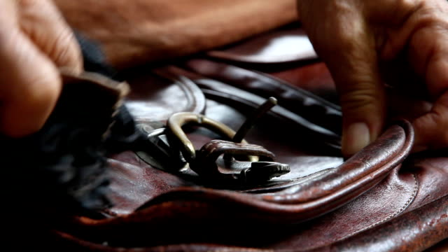 man wipe leather bags