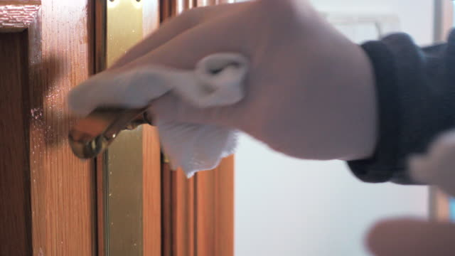 man wiping door knob in prevention for covid-19 coronavirus - handle stock videos & royalty-free footage