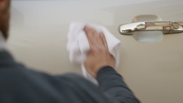 man wiping his car with a clean white cloth - polishing stock videos & royalty-free footage