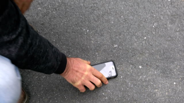 Man with a broken cracked phone screen